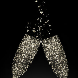 22740251 - glasses of champagne made of bubbles, isolated on black background